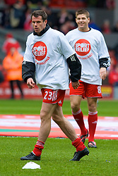LIVERPOOL, ENGLAND - Saturday, March 8, 2008: Liverpool's Jamie Carragher and captain Steven Gerrard MBE wearing Sport Relief t-shirts warm up before the Premiership match against Newcastle United at Anfield. (Photo by David Rawcliffe/Propaganda)