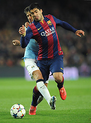 Barcelona's Luis Suarez is tackled by Manchester City's Martin Demichelis - Photo mandatory by-line: Dougie Allward/JMP - Mobile: 07966 386802 - 18/03/2015 - SPORT - Football - Barcelona - Nou Camp - Barcelona v Manchester City - UEFA Champions League - Round 16 - Second Leg