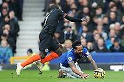 Chelsea midfielder Ngolo Kante (7) tackles Everton forward Theo Walcott (11)  during the Premier League match between Everton and Chelsea at Goodison Park, Liverpool, England on 7 December 2019.