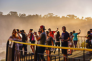 Tourists on platforms, Iguazu Falls, Brazil