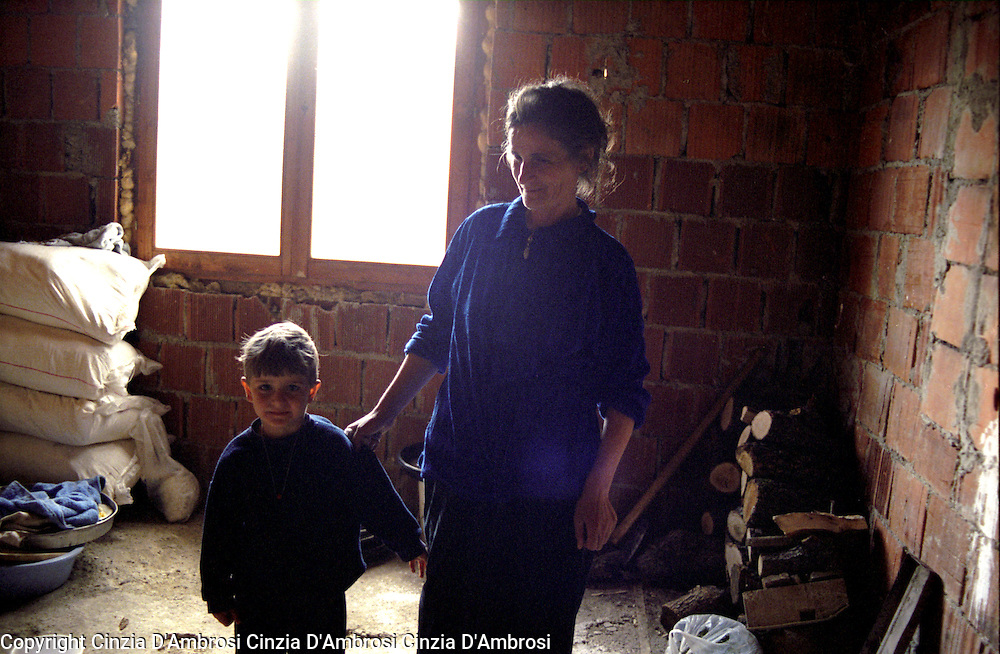 Widows of war in Kosovo.  After the war, some of villages like Meje have no men left.  Many widows have no means of sustainment.  Ngos assisted the widows in rebuilding their homes.  However, the Ngos support has diminished to null after they have been moved to  Iraq and Afghanistan.  This decision has left the widows in unfinished homes and no one to turn to for any support.
