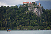A tourist boat on the still waters of Lake Bled, on 18th June 2018, in Bled, Slovenia.
