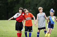 Jonathan Bright blinds James Barks as Jackson and Regan (right) Horn goof off during a break at Opelika Parks and Rec Challenger Soccer camp Thursday.  Photo by Elliot Knight