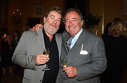 Left to right, PATRICK MEEHN of Handmade Films and SIR DAI LLEWELLYN at a private view of jewellery designed and made by Luis Miguel Howard held at 30 Pavillion Road, London on 27th October 2004.<br /><br />NON EXCLUSIVE - WORLD RIGHTS