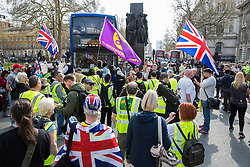 London, UK. 30th March, 2019. Pro-Brexit activists from Yellow Vests UK block traffic outside Downing Street during an event billed as the Great British Betrayal Rally.