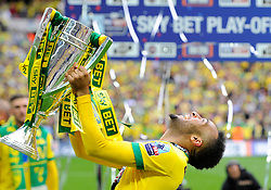 Norwich City's Nathan Redmond lifts the sky bet football league trophy as Norwich City win promotion to the premier league   - Photo mandatory by-line: Joe Meredith/JMP - Mobile: 07966 386802 - 25/05/2015 - SPORT - Football - London - Wembley Stadium - Middlesbrough v Norwich - Sky Bet Championship - Play-Off Final
