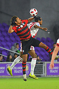 Flamengo midfielder Willian Arao (5) and Ajax midefielder Ryan Gravenberch (38) go airborne for a ball during a Florida Cup match at Orlando City Stadium on Jan. 10, 2019 in Orlando, Florida. <br /> Flamengo won in penalties 4-3.<br /> <br /> ©2019 Scott A. Miller