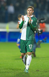OSIJEK, CROATIA - Tuesday, October 16, 2012: Wales' Simon Church applauds the travelling supporters after his side's 2-0 defeat by Croatia during the Brazil 2014 FIFA World Cup Qualifying Group A match at the Stadion Gradski Vrt. (Pic by David Rawcliffe/Propaganda)