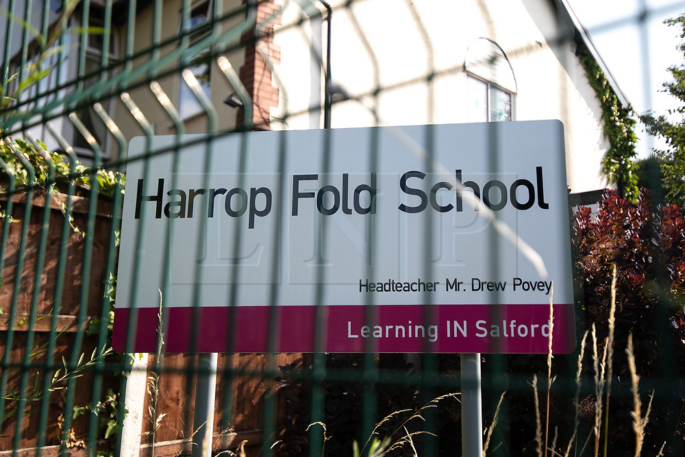 """© Licensed to London News Pictures. 19/07/2018. Salford, UK. Harrop Fold School in Little Hulton is closed for a protest by parents , objecting to the outcome of a months-long investigation in to record keeping which, it is alleged, revealed that data relating to pupils' performance was embellished and which has seen the school's popular headmaster suspended from duty. Parents planned a protest following the suspension of head master Drew Povey alongside three other members of staff . The school , which has been featured in the documentary """" Educating Greater Manchester """" will remain closed throughout the day . Photo credit: Joel Goodman/LNP"""