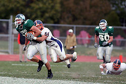 10 November 2007: Rick Podkowa pulls in a pass in the middle of the field and turns to run but is stopped short of the goal by Jesse Laizure. This game between the Wheaton College Thunder and the Illinois Wesleyan University Titans was for a share of the CCIW Championship and was played at Wilder Field on the campus of Illinois Wesleyan University in Bloomington Illinois.