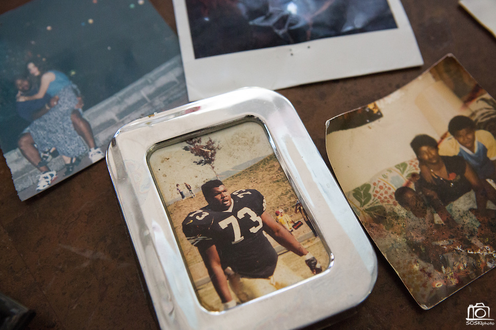 Old photos of former Dallas Cowboys guard Larry Allen, Jr. and his family lay on the kitchen table at his home in Danville, California, on June 27, 2013.  Allen will be inducted into the NFL Hall of Fame during the Enshrinement Ceremony at Fawcett Stadium in Canton, Ohio, on August 2, 2013. (Stan Olszewski for Fort Worth Star-Telegram)