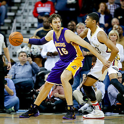 Nov 8, 2013; New Orleans, LA, USA;  Los Angeles Lakers center Pau Gasol (16) is guarded by New Orleans Pelicans power forward Anthony Davis (23) during the first half of a game at New Orleans Arena. Mandatory Credit: Derick E. Hingle-USA TODAY Sports