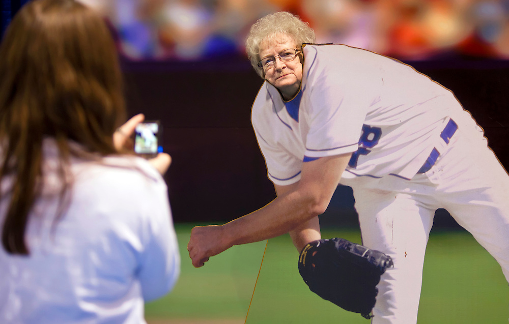 Donna Alger of Chanute spent months looking forward to attending the Royals FanFest at the Overland Park Convention Center, where she posed for a photo behind a cardboard cutout of a Royals pitcher while her niece, Ida Kaemmerling of Pittsburg, Kan., took her picture with her cell phone, left. Kaemmerling said she got her aunt to start watching Royals game last year and now she's a fan.
