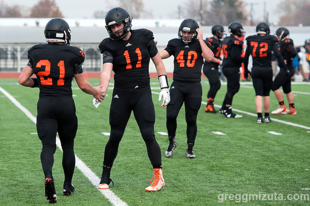 Justin Parazoo (#11) congratulates Anthony Johnson for  his 22 yard run during the Vale - Scio 3A semifinal playoff game at Kennison Field, Hermiston, Oregon, Saturday, November 21, 2015. Vale won 42-14.