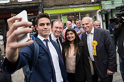 © Licensed to London News Pictures. 07/06/2017. Twickenham, UK. Liberal Democrat leader Tim Farron (2L) poses for a selfie as he campaigns in Twickenham with local candidate Vince Cable (R) on the last day of the election before the polls open. Photo credit: Peter Macdiarmid/LNP