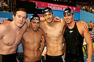 (L-R) Damien COURTOIS, Dimitri WAEBER, Flori LANG and Dominik MEICHTRY of Switzerland pose after competing - but before knowing that they have been disqualified due to a false take-over by Dominik MEICHTRY - in the men's 4x100m medley relay heats in the Susie O'Neill pool at the FINA Swimming World Championships in Melbourne, Australia, Sunday 1 April 2007. (Photo by Patrick B. Kraemer / MAGICPBK)