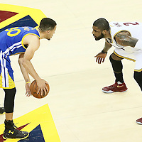 10 June 2016: Cleveland Cavaliers guard Kyrie Irving (2) defends on Golden State Warriors guard Stephen Curry (30) during the Golden State Warriors 108-97 victory over the Cleveland Cavaliers, during Game Four of the 2016 NBA Finals at the Quicken Loans Arena, Cleveland, Ohio, USA.
