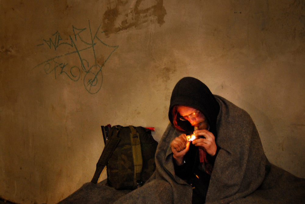 A homeless man smokes marijuana under a bridge in Ottawa, Ontario. Photo by Daniel Hayduk