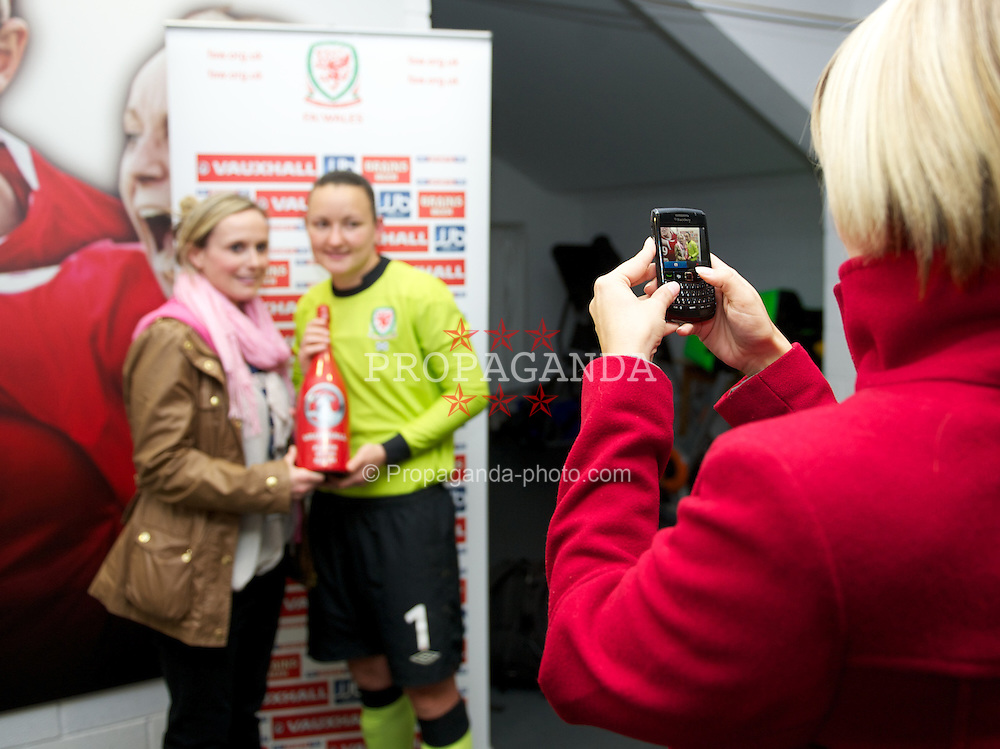 LLANELLI, WALES - Saturday, September 15, 2012: Wales' player of the match goalkeeper Nicola Davies receives a bottle of champagne from BBC's Cathy Williams after the 2-1 defeat by Scotland during the UEFA Women's Euro 2013 Qualifying Group 4 match at Parc y Scarlets. (Pic by David Rawcliffe/Propaganda)