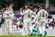 Wicket! Grant Stewart of Kent celebrates taking the wicket of Rory Burns of Surrey during the Specsavers County Champ Div 1 match between Surrey County Cricket Club and Kent County Cricket Club at the Kia Oval, Kennington, United Kingdom on 7 July 2019.