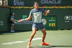 March 16, 2019 - Indian Wells, CA, U.S. - INDIAN WELLS, CA - MARCH 16: Milos Raonic (CAN) hits a forehand during the BNP Paribas Open on March 16, 2019 at Indian Wells Tennis Garden in Indian Wells, CA. (Photo by George Walker/Icon Sportswire) (Credit Image: © George Walker/Icon SMI via ZUMA Press)