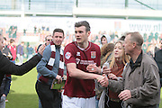 Northampton No 5 Zander Diamond accepting the congratulations of fans after the Sky Bet League 2 match between Northampton Town and Bristol Rovers at Sixfields Stadium, Northampton, England on 9 April 2016. Photo by Nigel Cole.