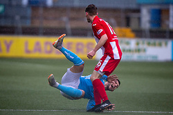 Forfar Athletic's Dylan Easton tackled by East Fife's Ross Davidson. Forfar Athletic 3 v 0 East Fife, Scottish Football League Division One game played 2/3/2019 at Forfar Athletic's home ground, Station Park, Forfar.