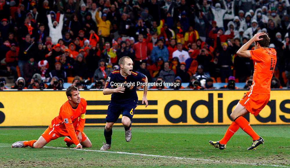 Spain's Andres Iniesta (C) celebrates after scoring the 1-0 lead during the FIFA World Cup 2010 Final match between the Netherlands and Spain at the Soccer City stadium outside Johannesburg, South Africa, 11 July 2010.  EPA/KERIM OKTEN Please refer to www.epa.eu/downloads/FIFA-WorldCup2010-Terms-and-Conditions.pdf