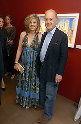 SIR JOHN & LADY LEON he is actor John Standing and she is Sarah Forbes daughter of Brian Forbes and Nanette Newman at a private view of artist Damian Elwes work 'Artists Studios' held at Scream, 34 Bruton Street, London W1 on 29th June 2006.<br />