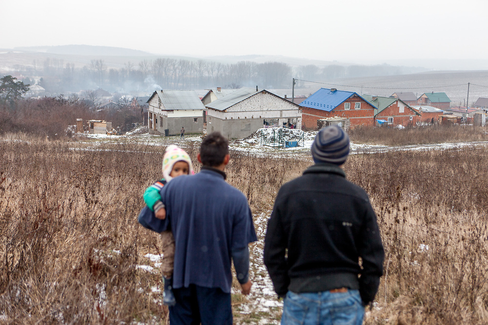 Rudo (25) with his daughter and Emil (20) are looking down a little hill to their selfconstructed buildings in Rankovce. Since almost two years (01/2016) the familie's are already able to life in the houses. They joined a micro loan program supported by the Slovak NGO ETP Slovakia in Rankovce.