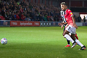 Salford City defender Ibou Touray going for the ball with the opponent during the EFL Sky Bet League 2 match between Salford City and Grimsby Town FC at Moor Lane, Salford, United Kingdom on 17 September 2019.