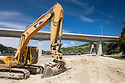 caterpillar excavating a new road to form part of the motorway extension of state highway 1, north of Auckland, New Zealand