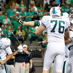 Oct 5, 2013; New Orleans, LA, USA; Tulane Green Wave kicker Cairo Santos (19) is held up by teammates as they celebrate a game winning field goal against the North Texas Mean Green during the fourth quarter at Mercedes-Benz Superdome. Tulane defeated North Texas 24-21. Mandatory Credit: Derick E. Hingle-USA TODAY Sports