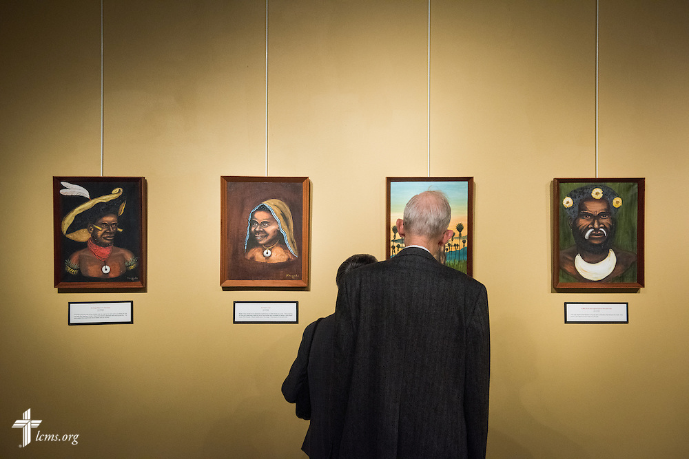 Tom and Ruth Donner browse artwork during the public opening of Concordia Historical Institute's museum exhibit 'Bringing Christ to the Highlands' in Papua New Guinea on Sunday, Oct. 5, 2014, on the campus of Concordia Seminary in Clayton, Mo. LCMS Communications/Erik M. Lunsford