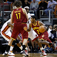 24 January 2012: Cleveland Cavaliers point guard Kyrie Irving (2) drives past Miami Heat small forward LeBron James (6) on a screen set by Cleveland Cavaliers power forward Anderson Varejao (17) during the Miami Heat 92-85 victory over the Cleveland Cavaliers at the AmericanAirlines Arena, Miami, Florida, USA.