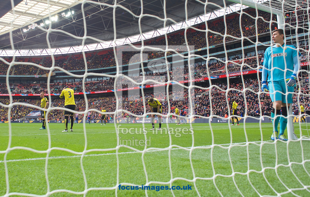 Watford players stand in dis-belief after Goalkeeper Costel Pantilimon of Watford is beaten by the header from Connor Wickham of Crystal Palace to make it 2-1 during the FA Cup semi-final at Wembley Stadium, London<br /> Picture by Alan Stanford/Focus Images Ltd +44 7915 056117<br /> 24/04/2016