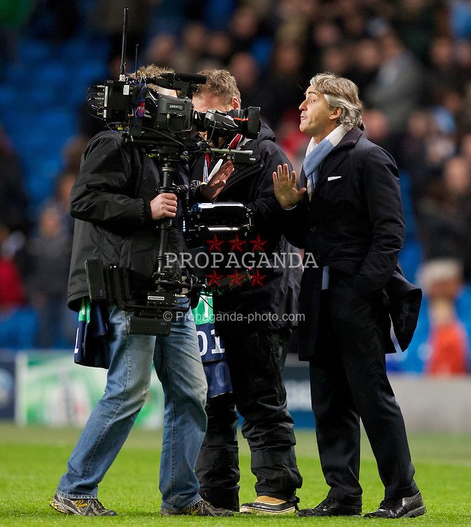 MANCHESTER, ENGLAND - Tuesday, November 6, 2012: Manchester City's manager Roberto Mancini reacts at a television camera-man after the UEFA Champions League Group D match against AFC Ajax at City of Manchester Stadium. (Pic by Vegard Grott/Propaganda)