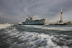 © Licensed to London News Pictures. 07/12/2016. Portsmouth, UK. Tugs tow the former Royal Navy aircraft carrier HMS Illustrious from Portsmouth on her final voyage to a scrap yard. Illustrious, the last of the Invincible Class carriers, has been sold to the Leyal Ship Recycling and Dismantling company in Aliaga, Turkey - the same yard dismantled her sister ships Ark Royal and Invincible. Photo credit: Peter Macdiarmid/LNP