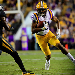 Oct 1, 2016; Baton Rouge, LA, USA;  LSU Tigers wide receiver Travin Dural (83) runs past Missouri Tigers defensive back John Gibson (5) during the first half of a game at Tiger Stadium. LSU defeated Missouri 42-7. Mandatory Credit: Derick E. Hingle-USA TODAY Sports