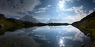 Reflexions of the Aiguille Verte, Les Drus, Les Aiguilles de Chamonix and Mont Blanc in the Lacs des Cheserys at night with clouds and moonshine, Chamonix, France / Impressionen bei den Lacs des Cheserys oberhalb von Chamonix, Mont-Blanc, an einem Spätsommertag im September