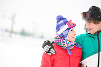 Loving young couple looking at each other in snow
