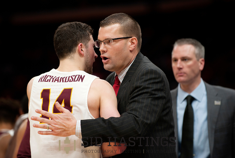 Loyola University Chicago basketball player Marques Townes (14) greets Bradley University head coach Brian Wardle after the Ramblers' beat the Braves during the semifinals of the Missouri Valley Conference men's basketball tournament at Scottrade Center in St. Louis Saturday, March 3, 2018. LUC won, 62-54. Photo © copyright 2018 Sid Hastings.