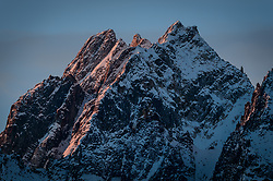Early morning sunlight reaches the top peaks of Mt. Emmerich near Haines, Alaska in this photo taken in late October. On July 6, 2015, two Haines women, Jessica Kayser Forster and Jenn Walsh, summited Mount Emmerich. They are believed to be the first women to have summited the 6,400-foot mountain known locally as Cathedral Peaks.