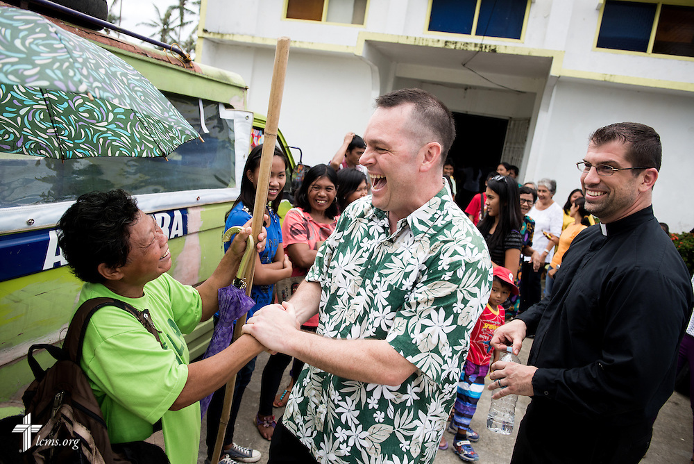 Missionary Sean Harlow (center) and the Rev. Ross Johnson, director of LCMS Disaster Response, greet members following worship at Christ Lutheran Church in Mahayag, Leyte Province, Philippines, on Sunday, March 16, 2014. LCMS Communications/Erik M. Lunsford