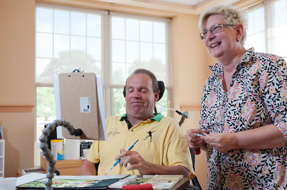 Art instructor Susan Krause leads a class at The Boston Home which cares for residents with multiple sclerosis and other neurological diseases.