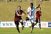 Andre Coker controlling the loose ball during the Pre-Season Friendly match between Lewes FC and Crystal Palace at the Dripping Pan, Lewes, United Kingdom on 1 August 2015. Photo by Michael Hulf.