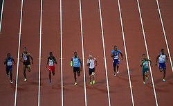 London, August 10 2017 . Ramil Guliyev, Turkey, and Wayde van Niekerk, South Africa, and Jereem Richards, Trinidad and Tobago battle with Nethaneel Mitchell-Blake, Great Britain for line honours,in the men's 200m final on day seven of the IAAF London 2017 world Championships at the London Stadium. © Paul Davey.