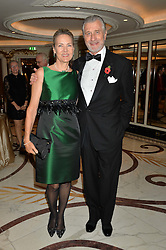 ARNAUD BAMBERGER Executive Chairman Cartier Ltd. and his wife CARLA at the 24th Cartier Racing Awards held at The Dorchester, Park Lane, London on 11th November 2014.