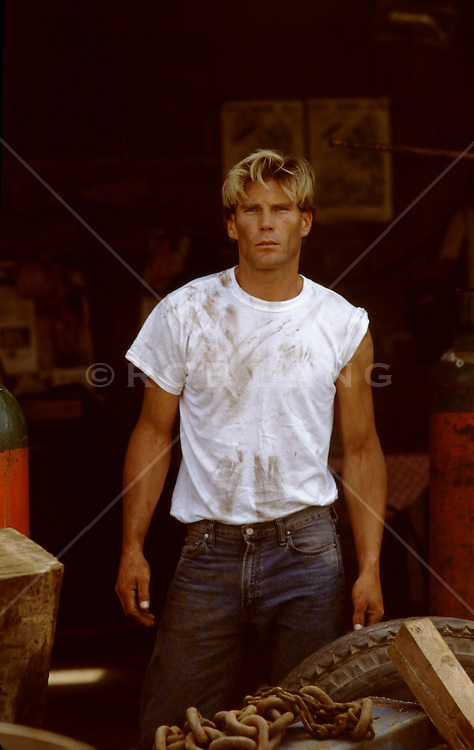auto mechanic standing in a garage