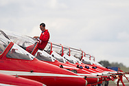 A Red Arrows pilot cleans his canopy before the aerobatic display at the Cotswold Air Show/Best of Britain Show.Cirencester, UNITED KINGDOM. August 26 2012.<br /> Photo Credit: Mark Chappell<br /> &copy; Mark Chappell 2012. All Rights Reserved. See instructions.